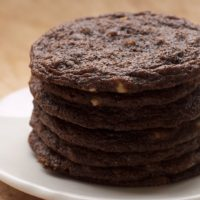 Chewy Chocolate Cookies stacked on a white plate