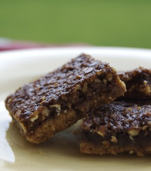 Chocolate Pecan Pie Bars on a white plate