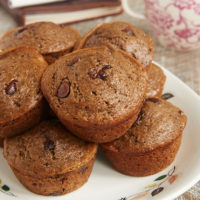 ChocolateChocolate Chocolate Chip Muffins on a white plate