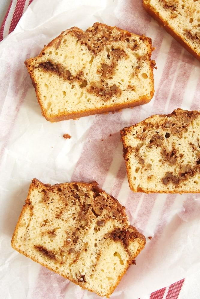 Cinnamon Swirl Bread slices on white parchment paper