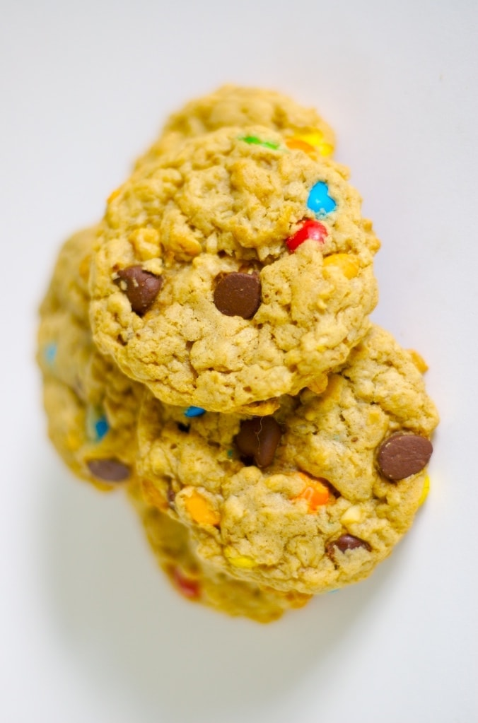 Monster Cookies stacked on a white surface