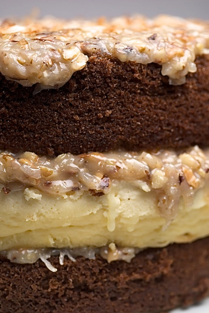 German Chocolate Cheesecake features a layer of rich cheesecake between layers of chocolate cake. So decadent and delicious! - Bake or Break