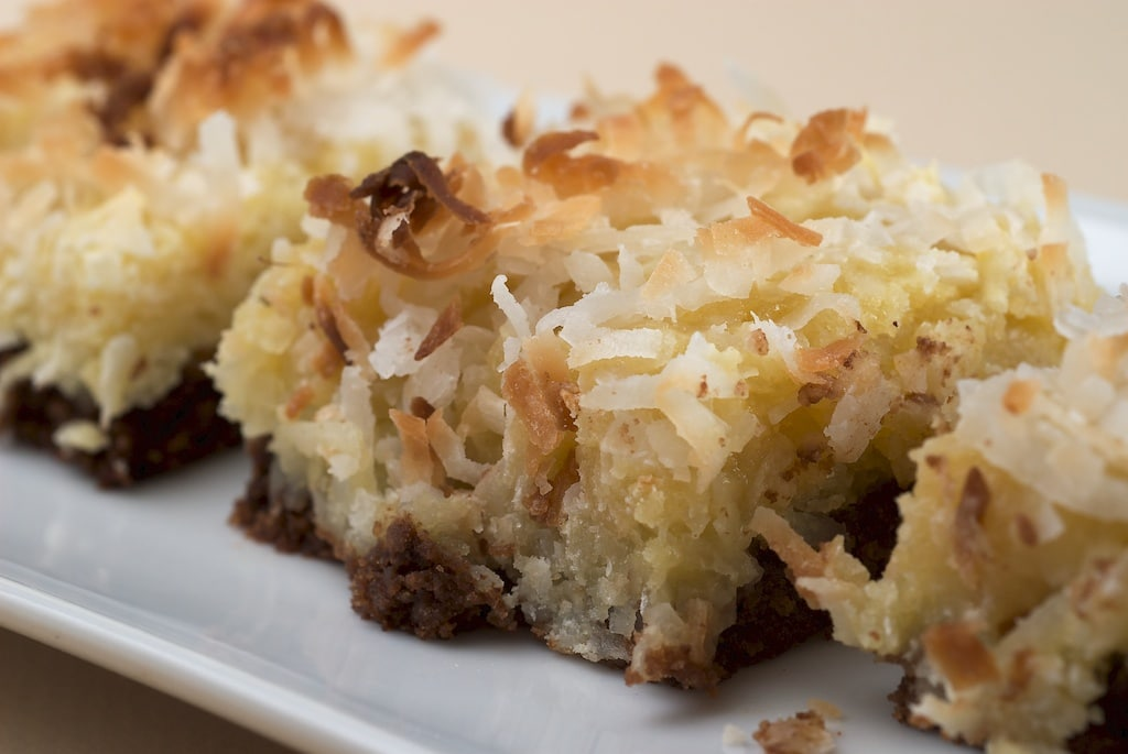 Black-Bottom Coconut Bars feature a wonderfully, gooey, coconut-y mixture on top of a thin brownie. - Bake or Break