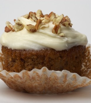 Hummingbird Cupcake topped with cream cheese frosting and chopped nuts