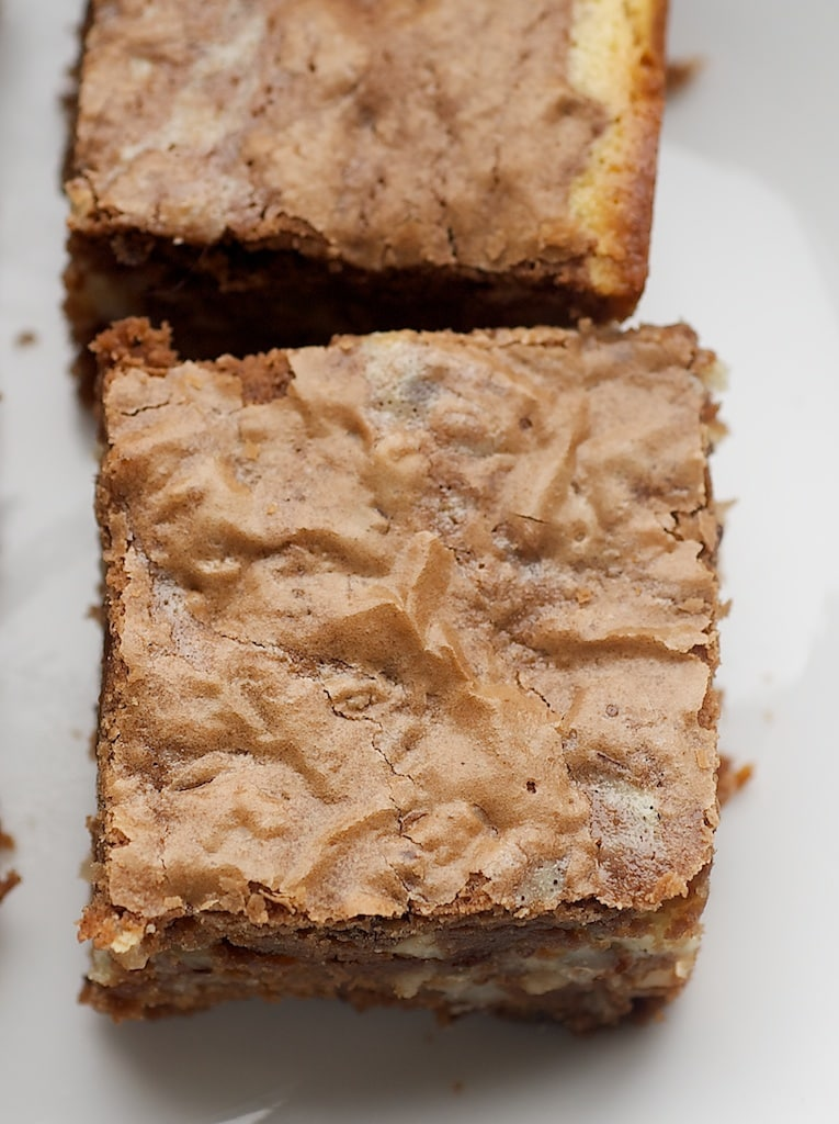 Hazelnut Cream Cheese Brownies are rich brownies packed with hazelnuts and swirled with a sweet cream cheese filling. - Bake or Break