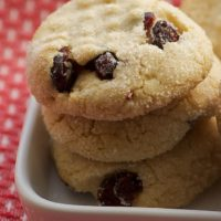 stack of Macadamia Butter Cookies with Dried Cranberries