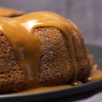 Apple Spice Cake topped with a caramel glaze