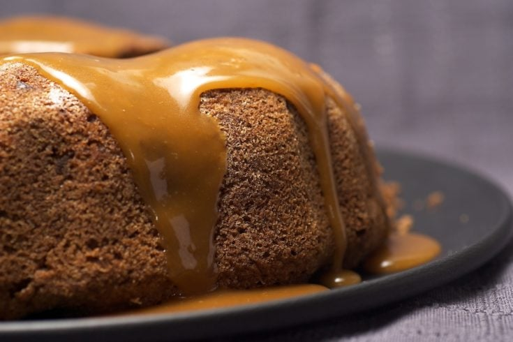 Apple Spice Cake topped with a caramel glaze