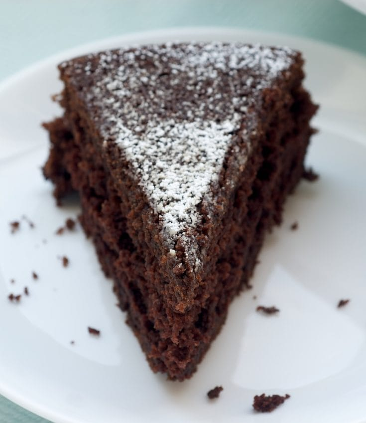 slice of Cocoa cake on a white plate