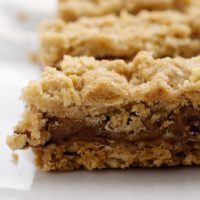 Gooey caramel is sandwiched between sweet oat layers in these delicious Caramel Oatmeal Bars. - Bake or Break