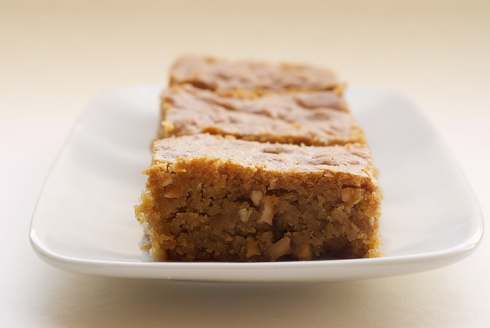 sliced Brown Sugar Cashew Blondies on a white tray