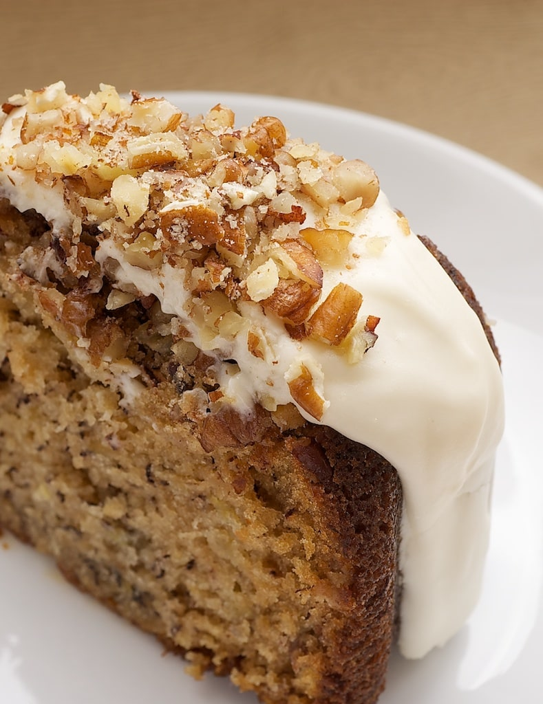 Hummingbird Bundt Cake features a delicious combination of bananas, pineapple, cinnamon, and nuts, all topped with a cream cheese glaze. - Bake or Break