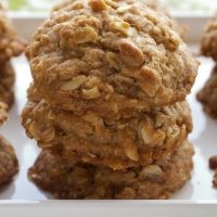 Toffee-Almond Oatmeal Cookies stacked on a white tray