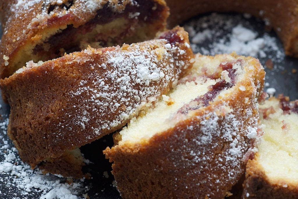 Black cherry preserves help make this Black Cherry Sour Cream Coffee Cake a lovely, sweet cake that's great for dessert or a coffee break.