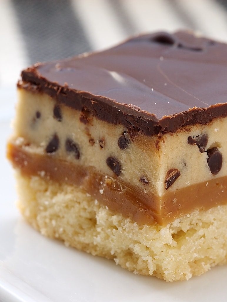 Cookie Dough Billionaire Bars feature delicious layers of crust, caramel, cookie dough, and chocolate. Incredible! - Bake or Break