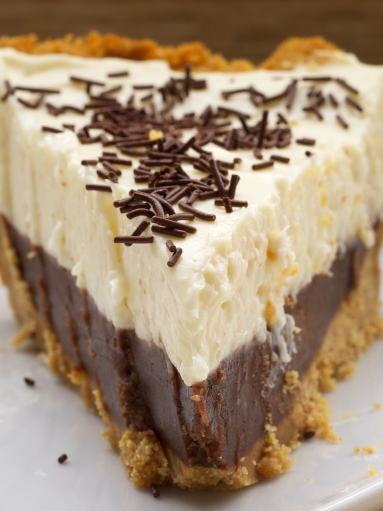 close-up shot of a slice of Chocolate Cookie Dough No-Bake Cheesecake