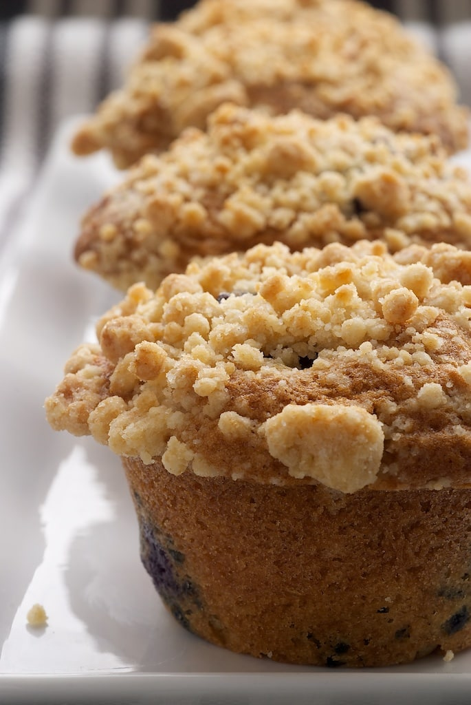 Blueberry Crumb Muffins are a classic breakfast treat. These traditional muffins get a little extra flavor from a sweet crumb topping. - Bake or Break