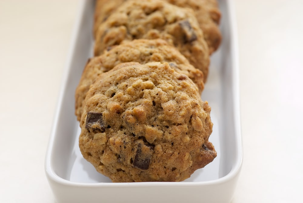 Banana Pecan Chocolate Chunk Cookies take chocolate chip cookies and amp them up with bananas, oats, and nuts. Delicious! - Bake or Break