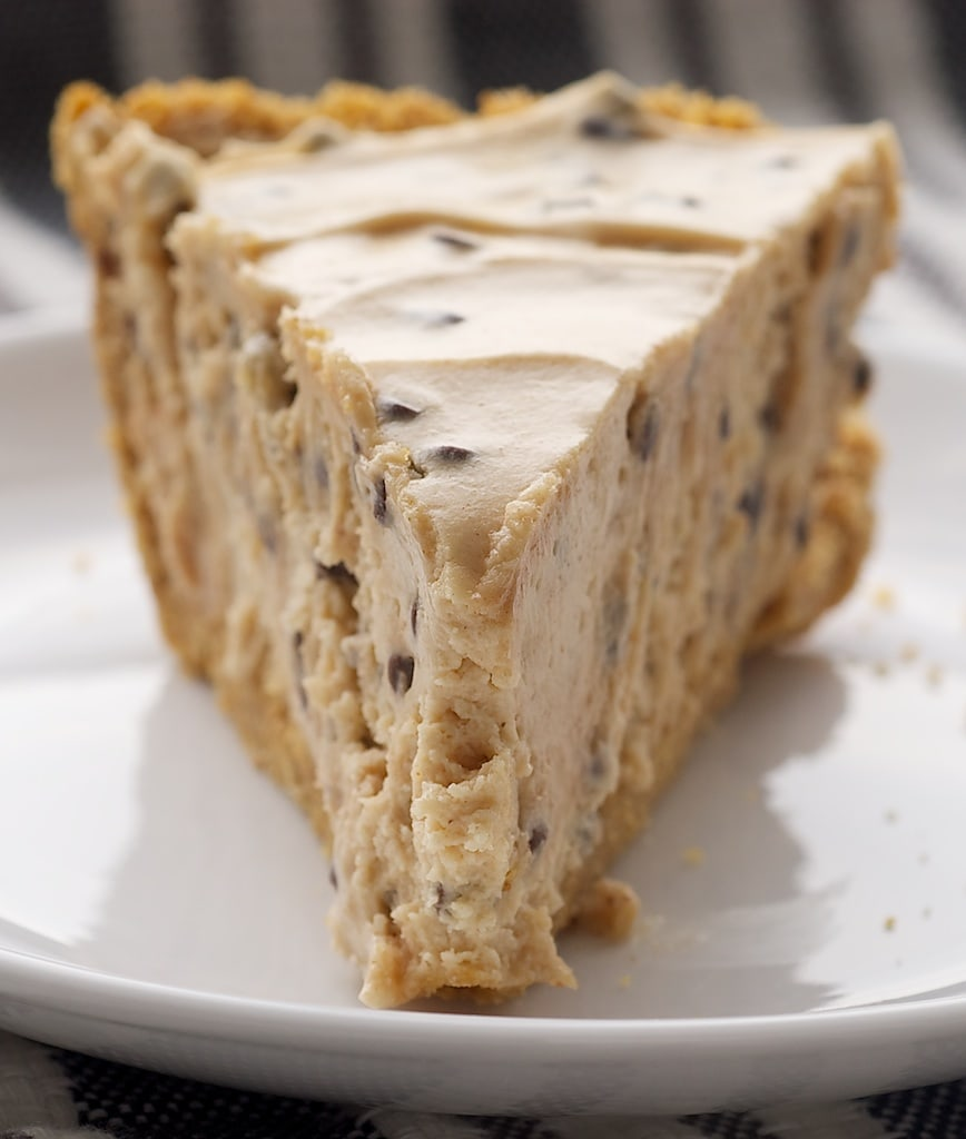 slice of Peanut Butter Chocolate Chip Pie on a white plate