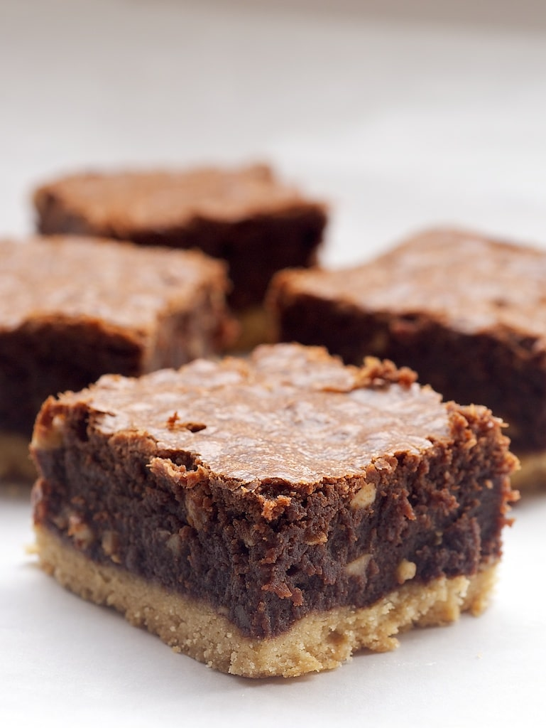 Nutella-Salted Shortbread Brownies combine rich brownies, sweet chocolate-hazelnut spread, and a slightly salty shortbread for an irresistible treat! - Bake or Break