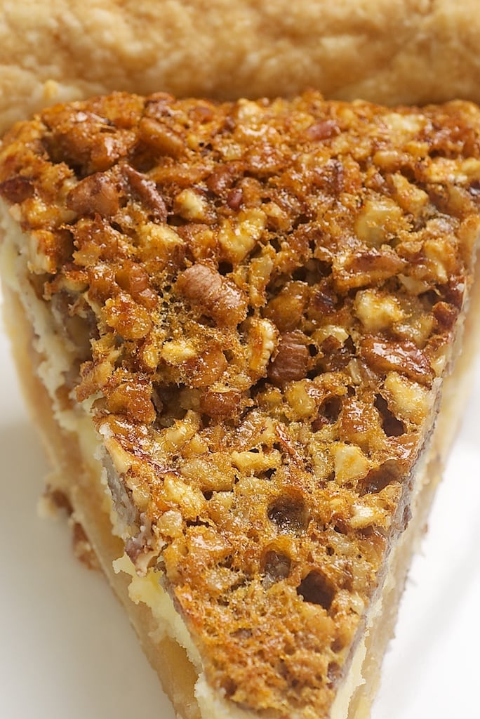 overhead view of a slice of Pecan Cheesecake Pie