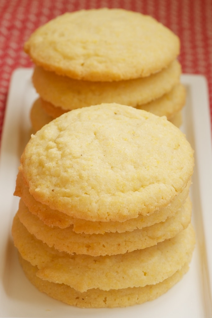 Cornmeal Cookies stacked on a white plate