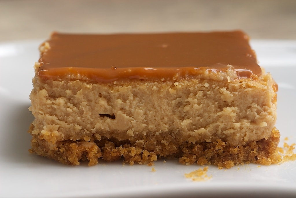 Dulce de Leche Cheesecake Bars are rich, creamy, delicious bars with dulce de leche both in the filling and the topping.