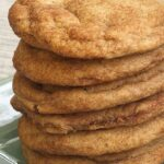 Brown Butter Snickerdoodles stacked on a green plate