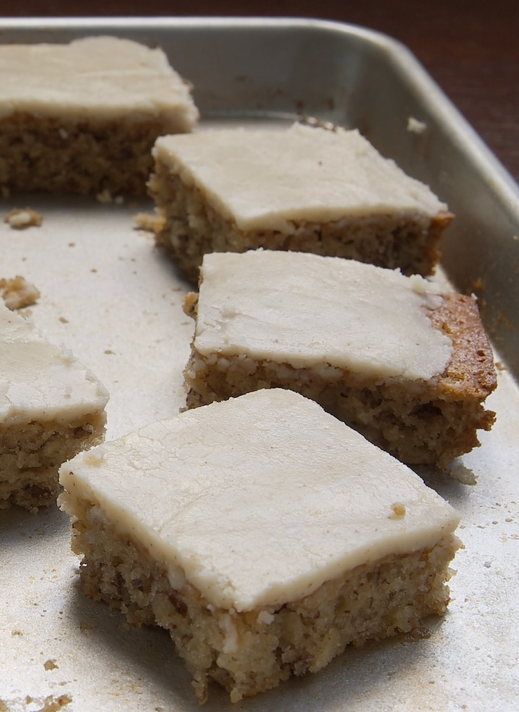 Banana Bars with Browned Butter Icing on a baking sheet
