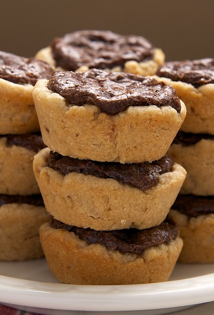 Peanut Butter Fudge Tartlets feature a peanut butter crust with a brownie-like filling. A great mini dessert!