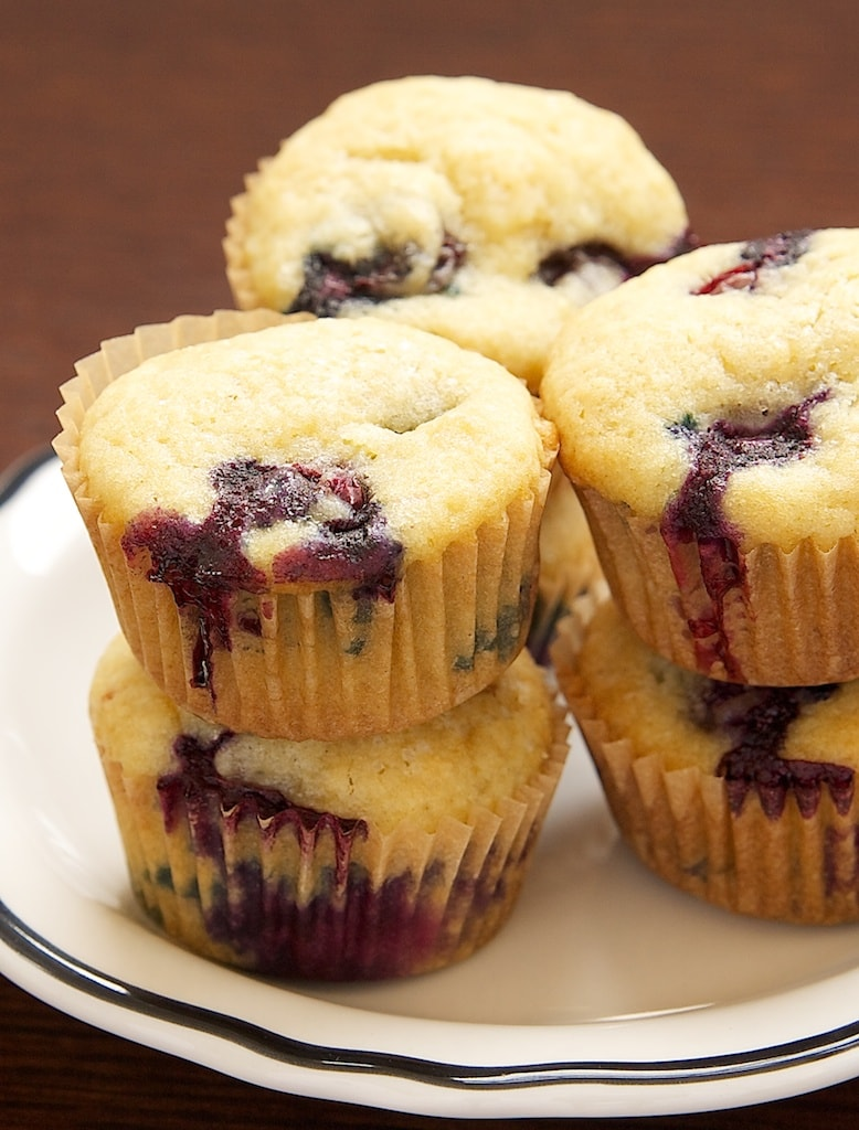 Blueberry Sour Cream Mini Muffins have plenty of fresh blueberries along with a hint of lemon. They're just the thing for a special breakfast treat! - Bake or Break