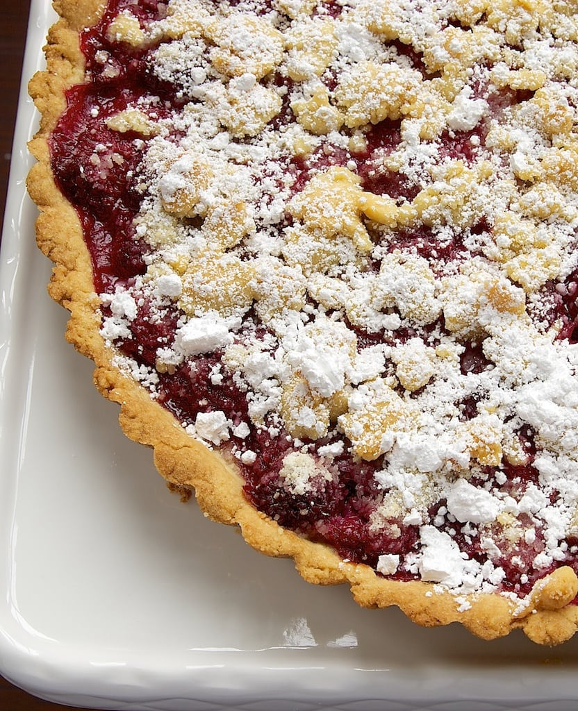 A sweet almond crust, fresh raspberries, and a crumb topping make this Raspberry Almond Crumb Tart a perfect summer dessert! - Bake or Break