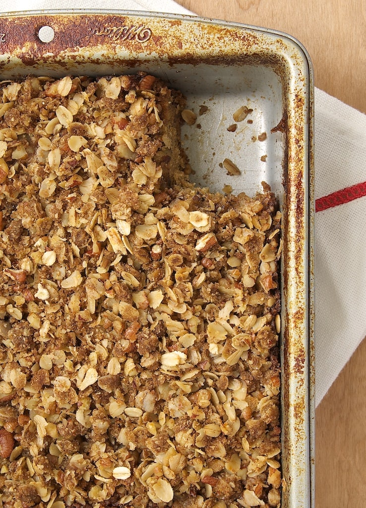 overhead shot of Banana Oatmeal Crumb Cake in a metal baking pan