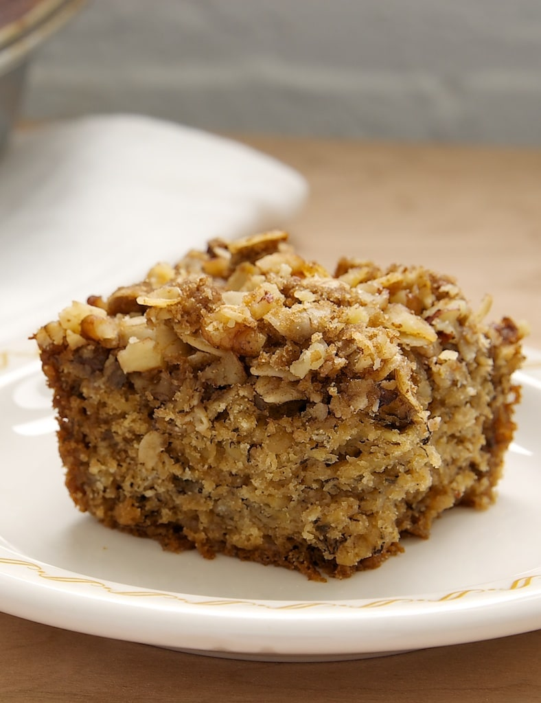 Banana Oatmeal Crumb Cake is a tasty cake that's a little bit banana bread and a little bit coffee cake. Serve this one from breakfast to dessert! - Bake or Break