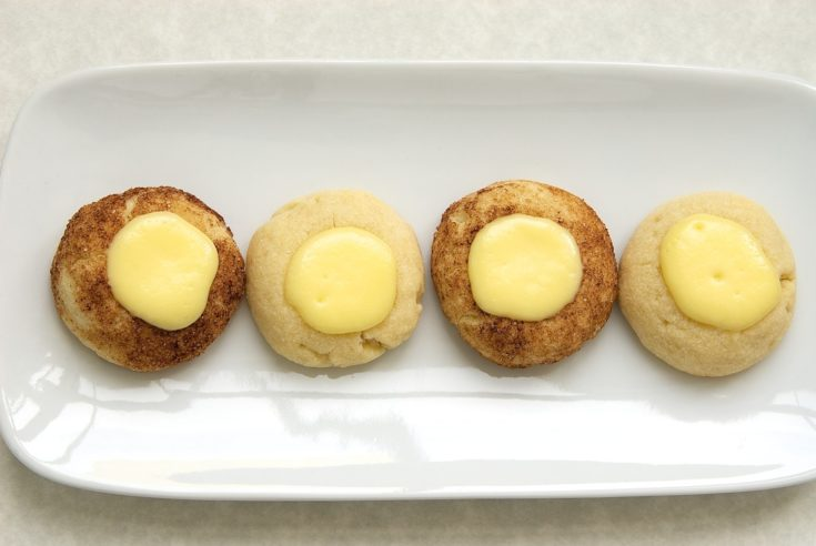 overhead view of Cheesecake Thumbprint Cookies on a white plate
