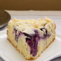 Fresh blueberries, cream cheese, almonds, and a buttery cake combine in Blueberry Cream Cheese Coffee Cake. Perfect for everything from brunch to dessert!
