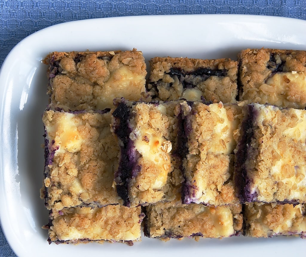 Blueberry Jam-Cream Cheese Bars served on a white tray
