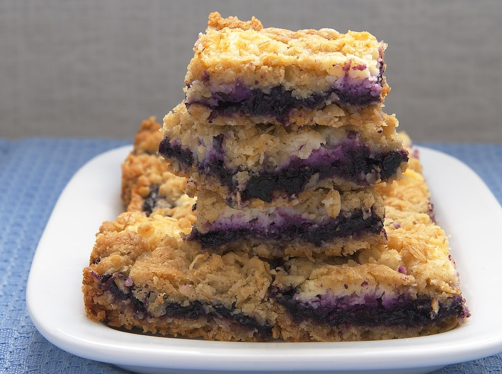 Blueberry Jam-Cream Cheese Bars stacked on a white plate