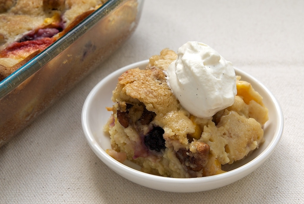 Blackberry Peach Cobbler is one of summer's perfect desserts. It's sweet, nutty, and delicious! - Bake or Break