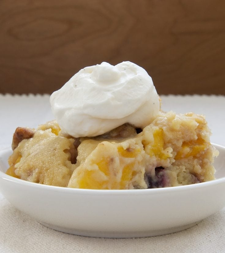 Blackberry Peach Cobbler served in a shallow white bowl