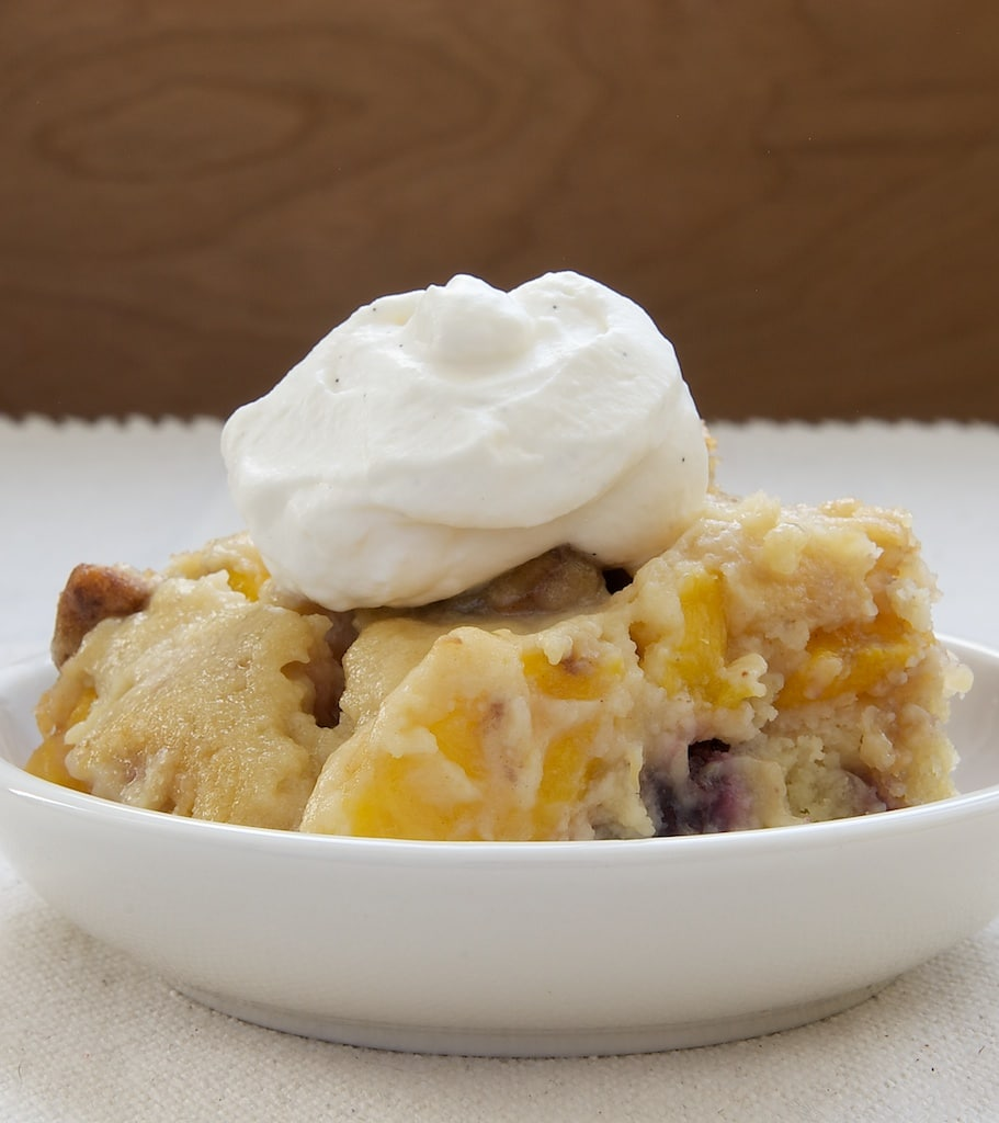 Blackberry Peach Cobbler topped with sweetened whipped cream