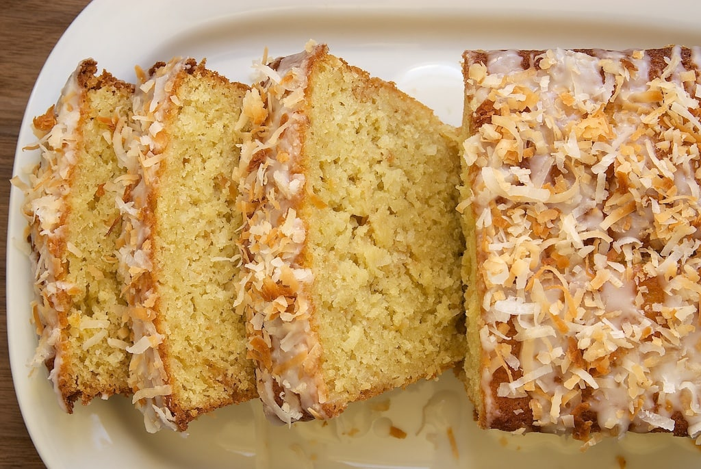 overhead view of sliced Coconut Buttermilk Pound Cake on a white plate