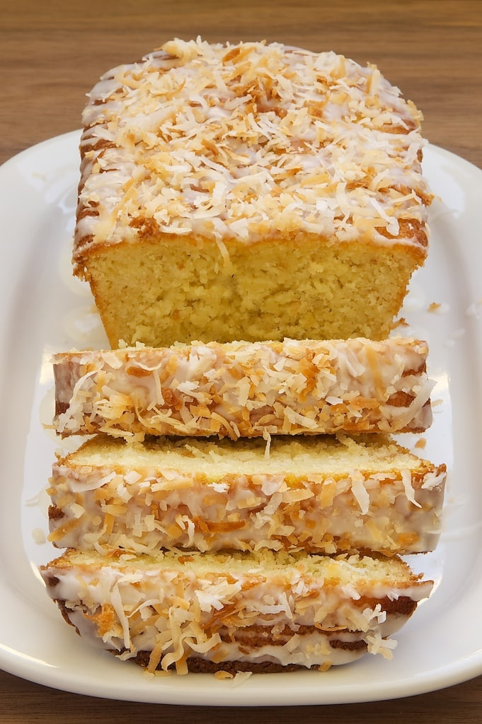 sliced Coconut Buttermilk Pound Cake topped with a sweet glaze and toasted coconut