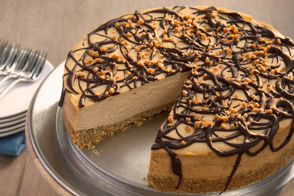 Rich peanut butter cheesecake tops off a salty pretzel crust in this delicious cheesecake. A sweet and salty dream!