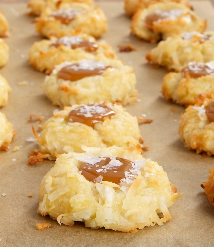 Coconut-Salted Caramel Thumbprint Cookies on parchment paper