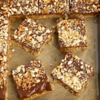 Peanut Butter-Chocolate-Oatmeal Cereal Bars on a parchment-lined baking sheet