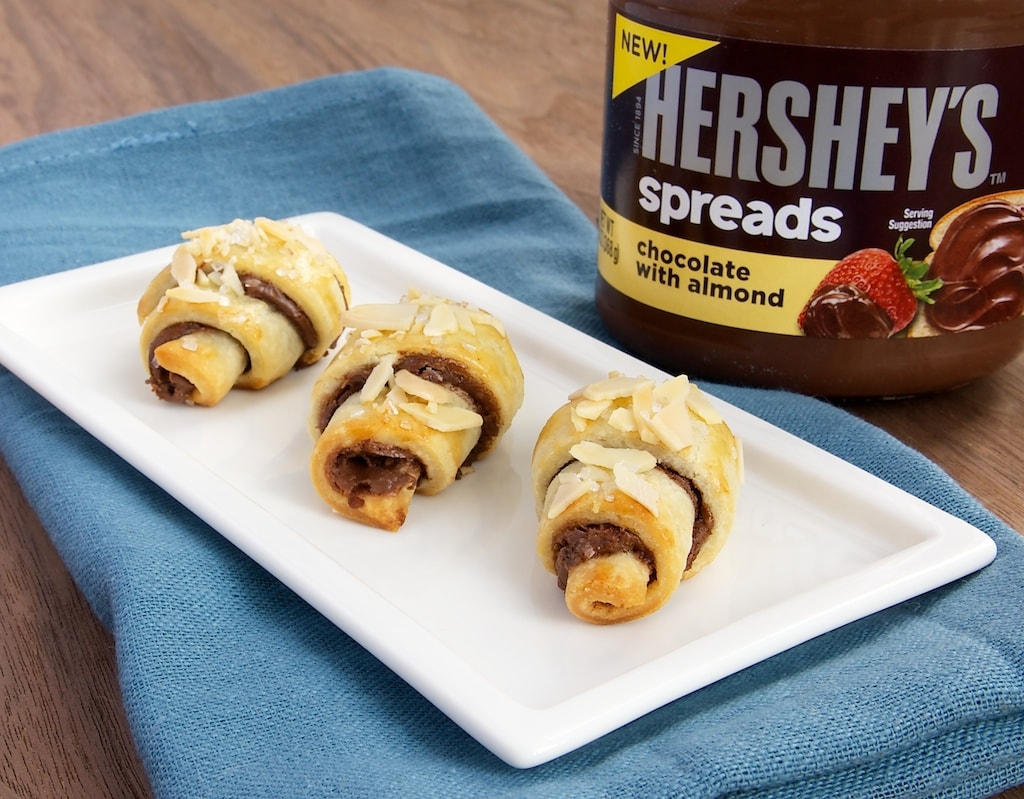 Chocolate Almond Roll-Ups are so simple to make with your favorite pie crust and chocolate-almond spread! - Bake or Break