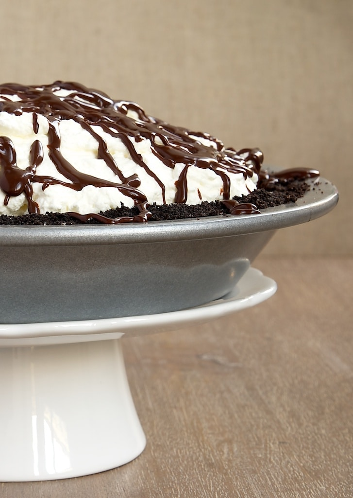 Chocolate cookie crust, hazelnuts, rich chocolate ganache, and sweetened whipped cream come together to make this delectable Chocolate Hazelnut Black-Bottom Pie. - Bake or Break