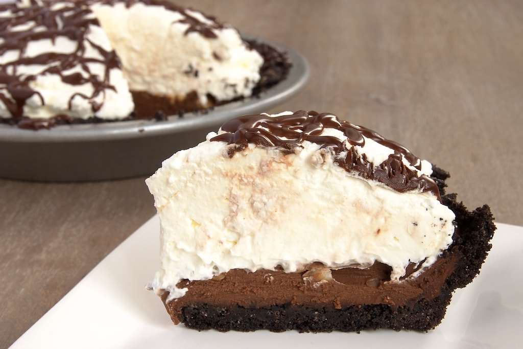 Chocolate Hazelnut Black-Bottom Pie combines a chocolate cookie crust, rich chocolate ganache, hazelnuts, and whipped cream for an irresistible dessert. - Bake or Break