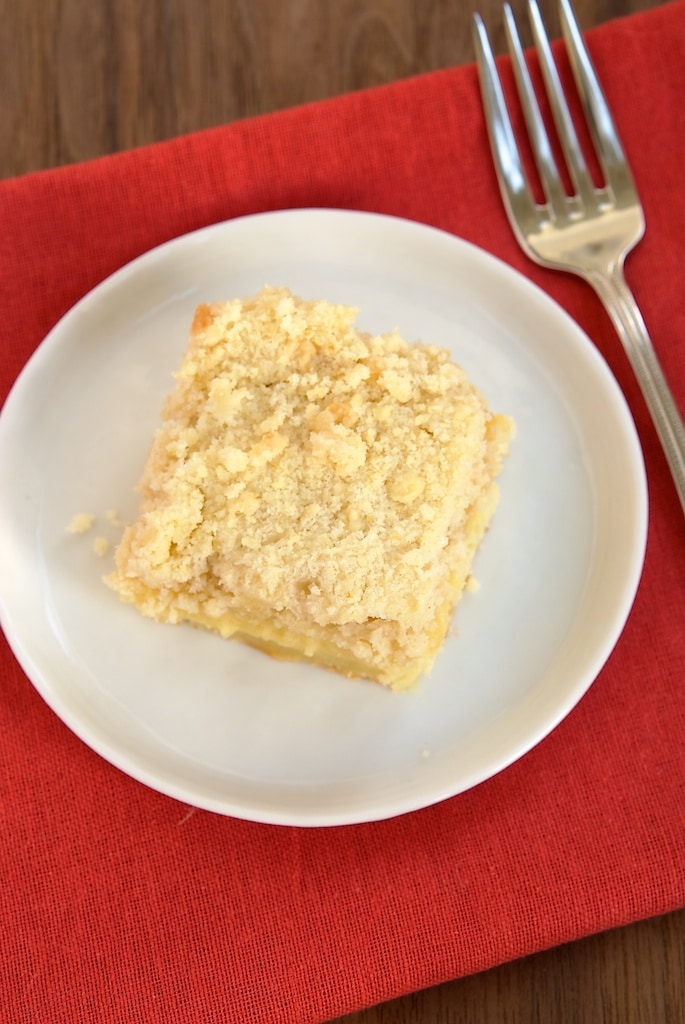 Fresh lemons and lemon curd star in this lovely, delicate Lemon Yogurt Crumb Cake.